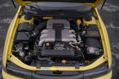 El motor de 6 cilindros bóxer del SVX rinde 230 CV.