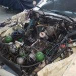 El motor sin las culatas listo para salir del coche.